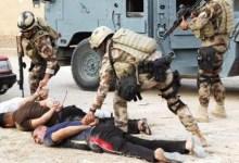 صورة اعتقال ارهابيين استهدفوا نقطة تفتيش غربي الموصل