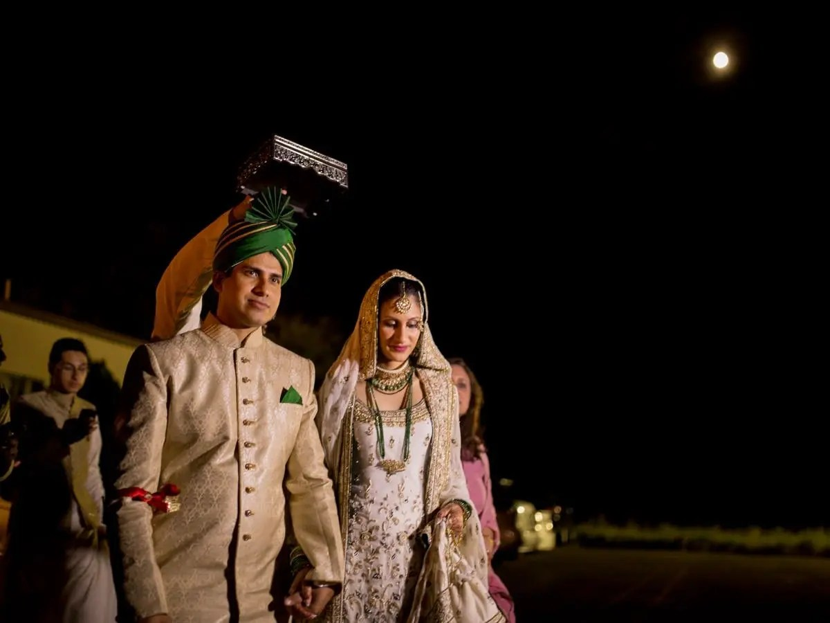 A Indian couple leave the mosque as a part of their Rukhsati in this moon lit photo.