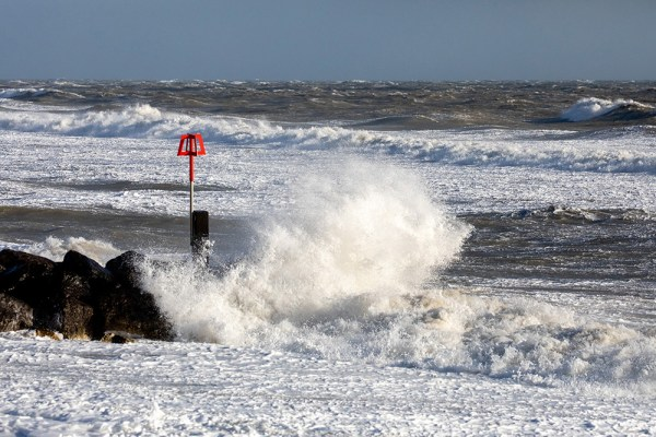 Breaking Waves on a Groyne