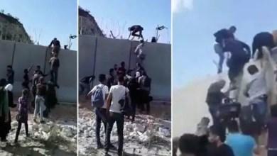 Photo of سوريون يتسلقون الجدار الاسمنتي و يتحدون الأسلاك الشائكة للوصول إلى تركيا ( فيديو )