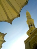 One of many minarets at Masjid Al-Nabawi. Outside, huge umbrellas provide shade for worshippers during the day.