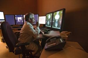 Radiologist interprets a diagnostic imaging chart