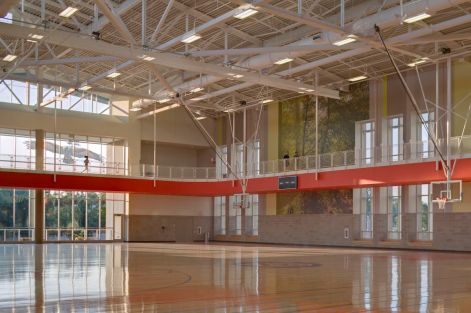 Along with basketball courts, the student recreation center also features a rock climbing wall. (Photo courtesy of HOK)