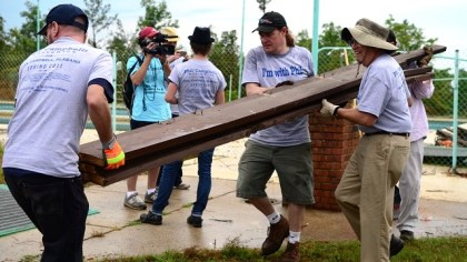 Men named Phil Campbell from across the country and the world help clean up the Alabama town of Phil Campbell following the devastating tornadoes of April 27, 2011, which practically wiped it out. (Contributed)