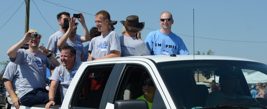 Several of the Phil Campbells from across the country and world who helped clean up the Alabama town of that name participate in a parade. (Contributed)