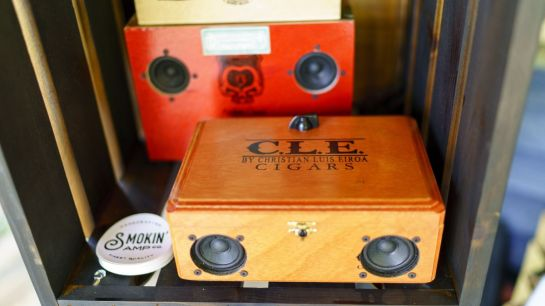 "Gabe turns old cigar boxes, coffee containers and even empty oil cans into guitar amps. ""It's a little tricky,"" he says. ""But from the beginning I wanted this to be about more than just the electronics."" (Mark Sandlin/Alabama NewsCenter)"