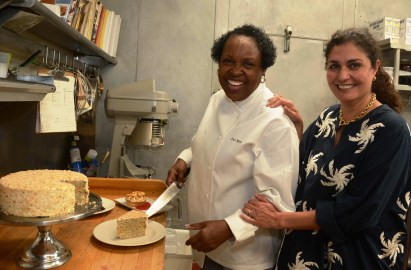 Dolester Miles with Pardis Stitt in the kitchen where Miles creates desserts for the Stitts' award-winning restaurants. (Karim Shamsi-Basha/Alabama NewsCenter)