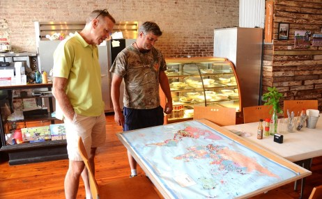 Seaborn Whatley, right, shows Iander Allen the map depicting the countries where Pie Lab visitors came from. (Karim Shamsi-Basha / Alabama NewsCenter)