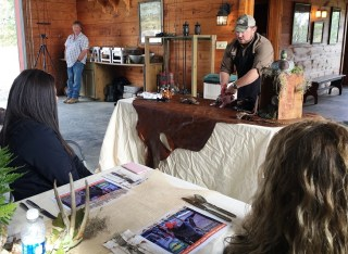 An expert from Pepper Tree Steaks N' Wines demonstrates how to field dress wild game birds for University of Montevallo students. (Brittany Faush-Johnson/Alabama NewsCenter)