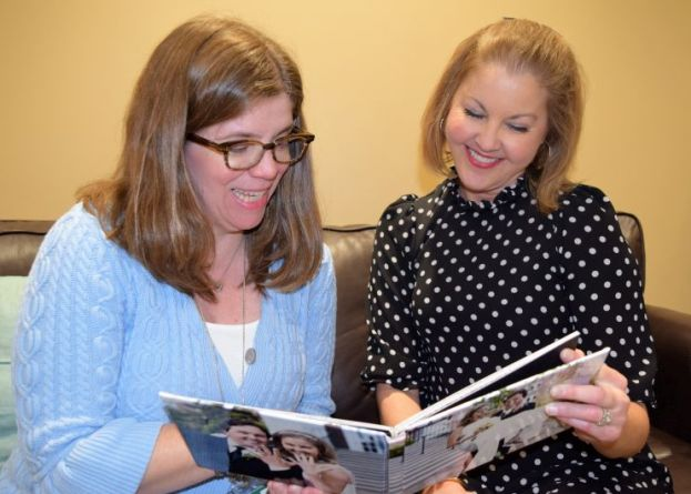 Berry (right) shares happy wedding memories with Rayburn. (Donna Cope / Alabama NewsCenter)