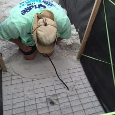 Mike Reynolds listens to a sea turtle nest with a stethoscope. (Share the Beach)