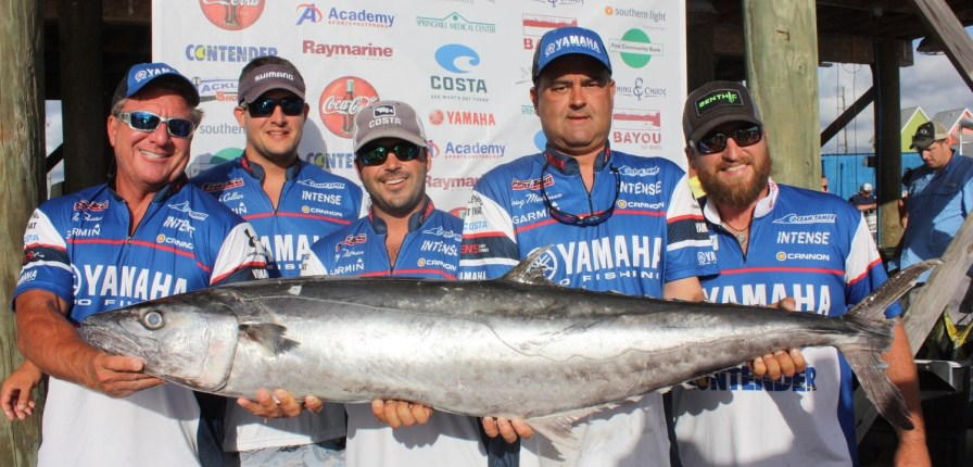 Neal Foster, far left, caught this 53.31-pound king mackerel that won the king mackerel division of the Alabama Deep Sea Fishing Rodeo. He is pictured with the Intense fishing team: from left, Josh Collier, Trey Tillman, Doug Mallonee and Austin Powell. (Robert DeWitt/Alabama NewsCenter)