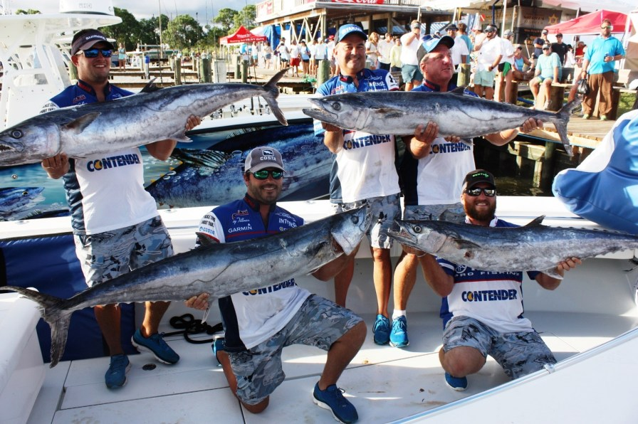 The Intense fishing team with its catch for the weekend, which included a 53.31-pound king mackerel that won the king mackerel division of the Alabama Deep Sea Fishing Rodeo. Standing, from left, are Josh Collier, Doug Mallonee and Neal Foster. Kneeling, from left, are Trey Tillman and Austin Powell. (Robert DeWitt/Alabama NewsCenter)