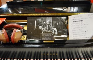A sheet on the piano lists a few of the hits recorded in this room. (Anne Kristoff/Alabama NewsCenter)