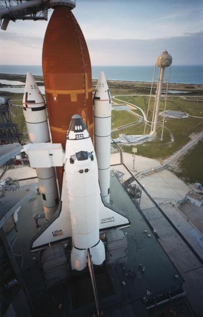(Aug. 29, 1984) Orbiter Discovery is poised on Launch Pad 39A as the sun sets the evening prior to its maiden launch. Space shuttle Discovery was successfully launched at 8:41 a.m. Aug. 30, 1984, after two failed attempts in June. The six-person crew includes Commander Henry Hartsfield, Pilot Michael Coats, Mission Specialists Judith Resnik, Mike Mullane and Steve Hawley and the first commercial payload specialist Charles Walker of McDonnell Douglas. (Photo Credit: NASA)
