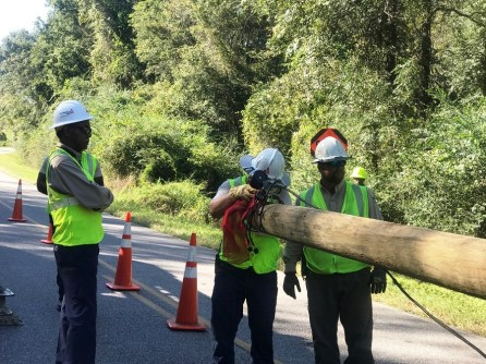 Alabama Power crews replace a pole near Eufaula after Tropical Storm Irma. (Linda Brannon / Alabama NewsCenter)