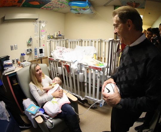 Alabama Head Coach Nick Saban visits a patient's room at the Ochsner Hospital for Children while in New Orleans for next week's Sugar Bowl. (Kent Gidley / University of Alabama Athletics)