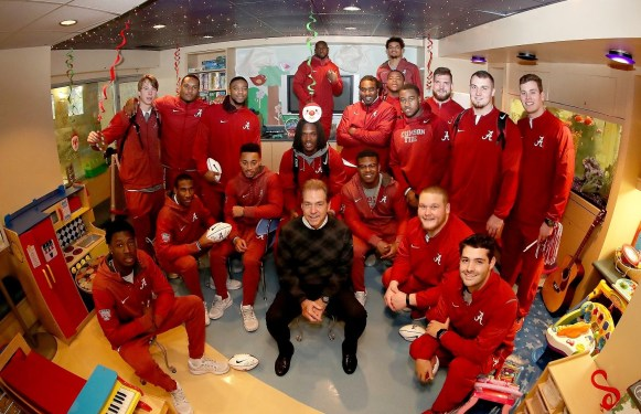 Nick Saban and his players bring the Tide to the kids at New Orleans' Ochsner Hospital for Children. (Kent Gidley / University of Alabama Athletics)