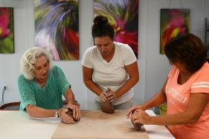 Maya Blume-Cantrell, center, is an artist and teacher at the Coastal Arts Center of Orange Beach. (Karim Shamsi-Basha / Alabama NewsCenter)