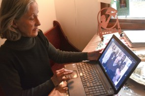 Brenda Hall looks at pictures of her late husband, Chris, on her laptop. Since his death, she has continued to volunteer with Mothers Against Drunk Driving. (Karim Shamsi-Basha / Alabama NewsCenter)