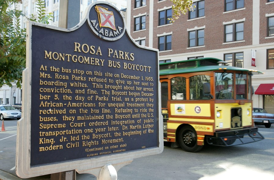 MONTGOMERY, AL - OCTOBER 28: A trolley passes the site where civil rights icon Rosa Parks was arrested December 1, 1955, for not giving up her bus seat to a white man October 28, 2005 in Montgomery, Alabama. Rosa Parks, who died Monday at the age of 92, changed history on December 1, 1955 when she refused to give up her seat on a city bus to a white passenger. Her arrest for this triggered a 381-day boycott of the Montgomery bus system. (Photo by Justin Sullivan/Getty Images)
