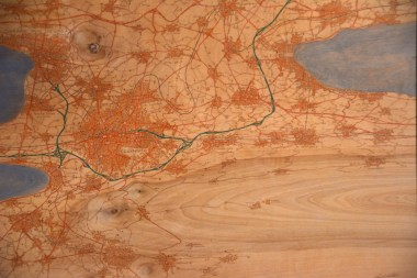 All of David Nuttall's maps are of imaginary places, but they're diverse in style and materials, including wood. (Karim Shamsi-Basha / Alabama NewsCenter)