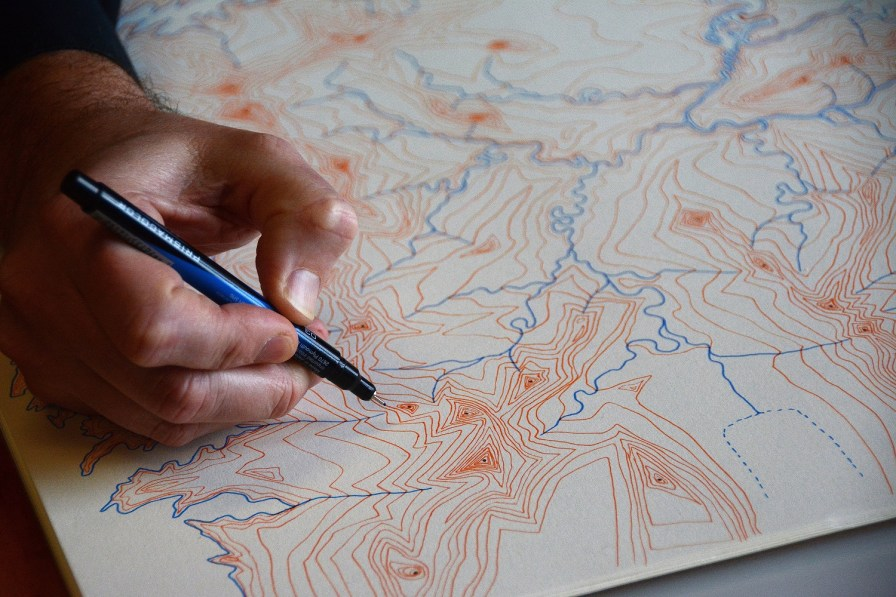 David Nuttall creates finely detailed maps of places that exist only in his mind. (Karim Shamsi-Basha / Alabama NewsCenter)