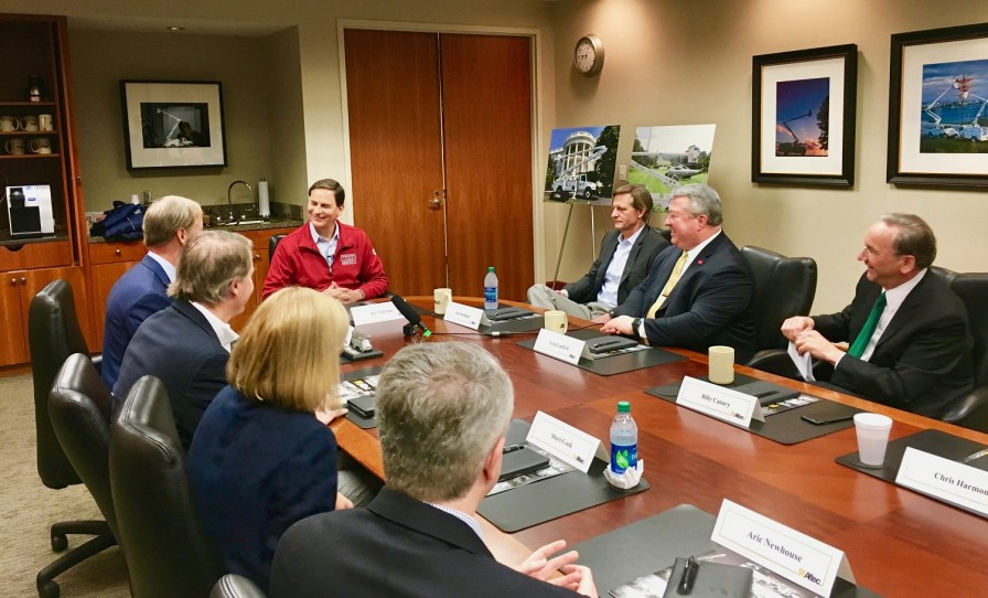 """National Association of Manufacturing President Jay Timmons, in red coat, speaks at a meeting at Altec during the organization's 2018 'State of Manufacturing"""" tour stop in Birmingham. (contributed)"""