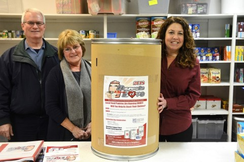 Working with Barrels of Love are, from left, Forest Keith, Wendy Taylor, and Gayle Monk. (Karim Shamsi-Basha / Alabama NewsCenter)