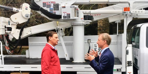 """Altec Inc. CEO Lee Styslinger III, right, speaks with Jay Timmons, president of the National Association of Manufacturers, during NAM's 2018 """"State of Manufacturing"""" tour stop in Birmingham. (contributed)"""