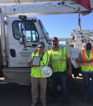 Nelson Seda of Puerto Rico with John Woody. Seda is a retired police office who assisted crews with traffic while they worked to restore outages. (Alabama Power file)