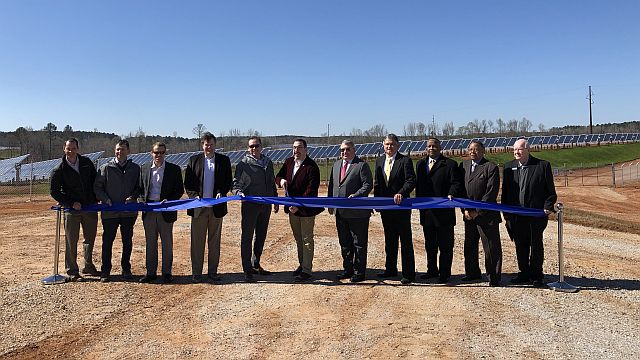 Leaders celebrate the successful launch of the AL Solar A facility
