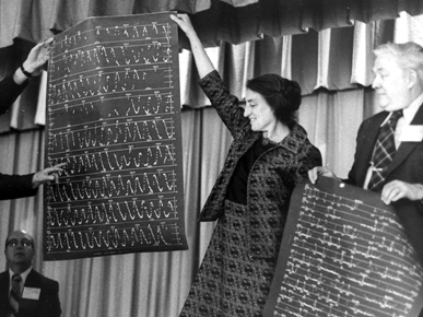 Dorrit Hoffleit holds a star chart at the Variable Star Conference in Stamford, Connecticut, 1973. To her right is American Association of Variable Star Observers Secretary Clinton B. Ford. Variable stars are those that change their brightness over time when observed by astronomers. (From Encyclopedia of Alabama, courtesy of the American Association of Variable Star Observers)