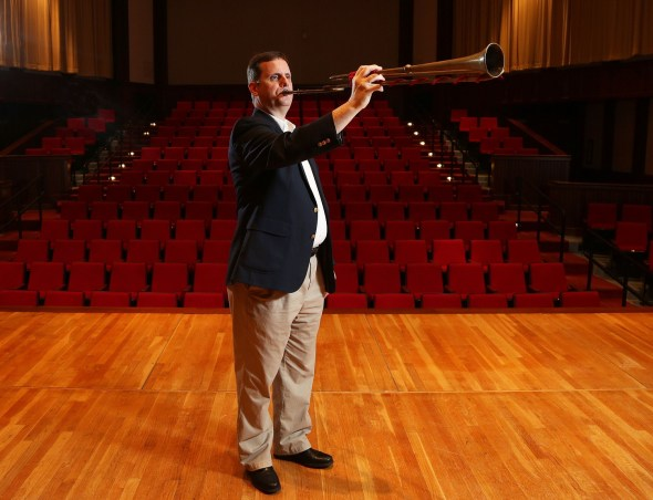 Dr. Peter Wood plays the replica of a 17th-century natural trumpet that he made by hand in an international workshop. (University of South Alabama)