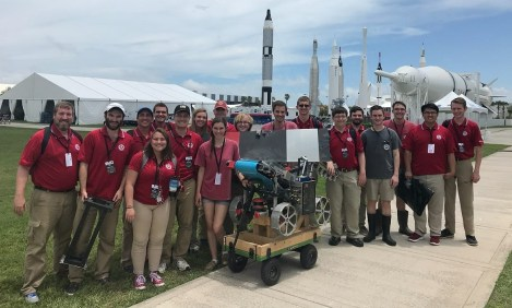 Some members of the winning University of Alabama team with the robot they designed and built. (contributed)