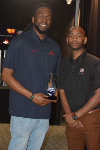 Tavaris Godbolt (left) and Alvin Miller, owners of the Shoe Clinic and winners of the pitch competition. (Stephonia Taylor McLinn for The Birmingham Times)