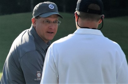 Auburn head football Coach Gus Malzahn greets a player on the driving range at Greystone Golf and Country Club. (Solomon Crenshaw/Alabama NewsCenter)