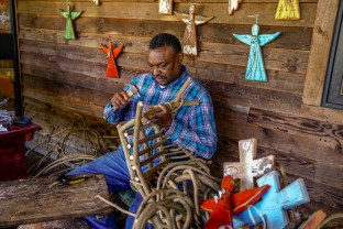 Andrew McCall has been making baskets from wisteria, kudzu and grape vines for almost 40 years. (Mark Sandlin/Alabama NewsCenter)