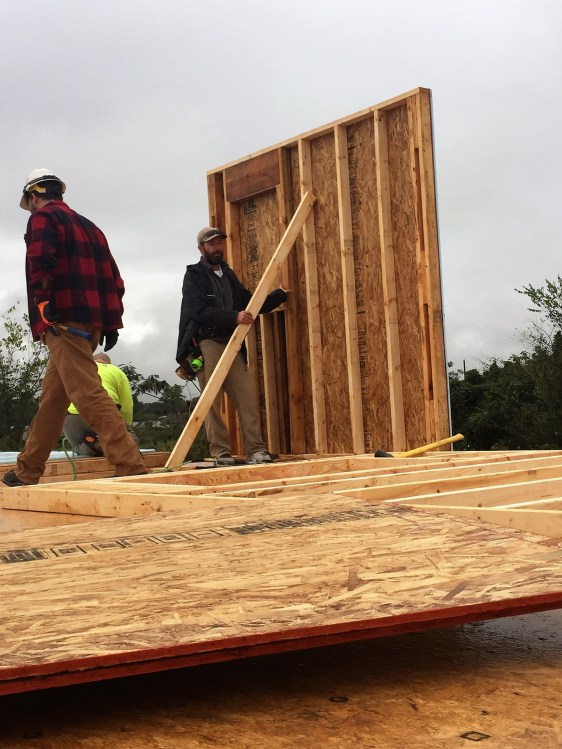 Volunteers including members of the Magic City Alabama Power Service Organization chapter and the International Brotherhood of Electrical Workers work on a Habitat for Humanity home in Pleasant Grove. (contributed)