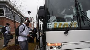 UAB football players board the bus headed to Boca Raton. (Brittany Faush)