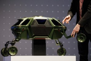 Byron points at Hyundai's Elevate walking-car concept. (Patrick T. Fallon/Bloomberg)