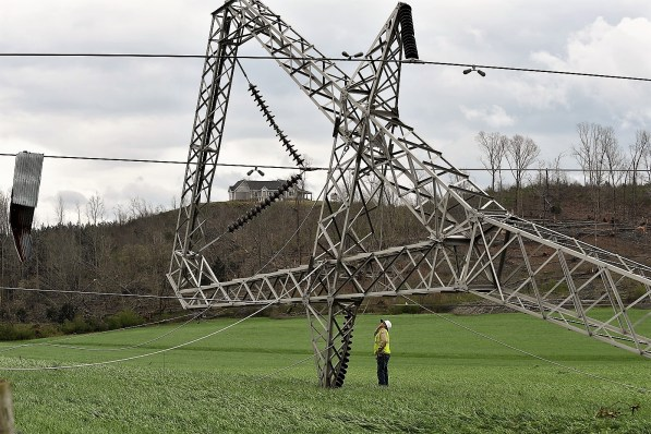 An Alabama Power crew member inspects power line damage after an EF-3 tornado swept through east Alabama in March 2018. (Phil Free/Alabama NewsCenter)