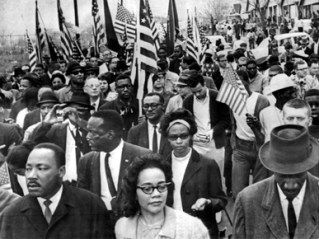 Martin Luther King Jr. and Coretta Scott King led thousands of protesters during the Selma to Montgomery March in March 1965. (From Encyclopedia of Alabama, courtesy of The Birmingham News)
