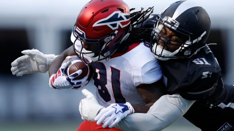 """The Birmingham Iron's Xzavier Dickson brings down Alton """"Pig""""Howard of the Memphis Express during opening weekend for the new Alliance of American Football. The Iron won its opener 26-0. (Joe Robbins/AAF/Getty Images)"""