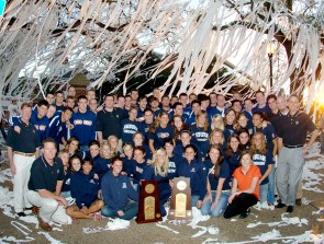 "The 2006 men's and women's AU championship swim teams pose at Toomer's Corner. Although football garners the most attention at Auburn, its swimming teams consistently finish at the top of their sport. A number of Auburn swimmers have medalled in the Olympics, including three-time gold-medalists Kristy Coventry and Ambrose ""Rowdy"" Gaines. (From Encyclopedia of Alabama, courtesy of Auburn University Photographic Services)"