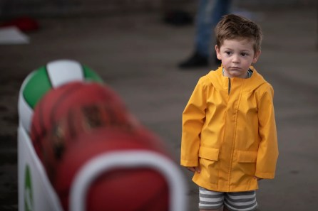 A young spectator watches the hoop shot competition. (Chris Jones/Alabama NewsCenter)