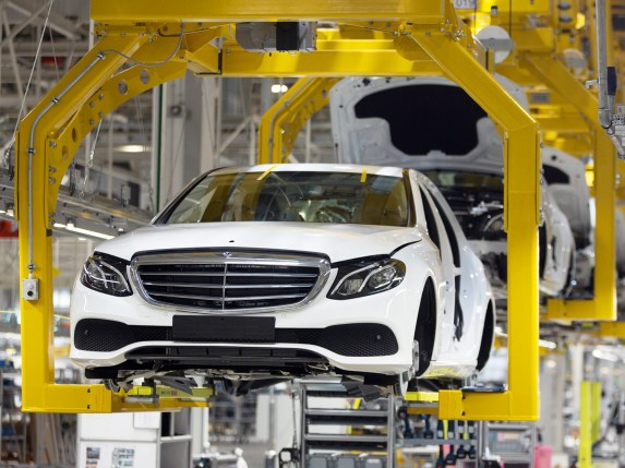 Mercedes-Benz E-Class automobiles move along the production line at the Daimler AG luxury automobile plant in Moscow. (Andrey Rudakov/Bloomberg)