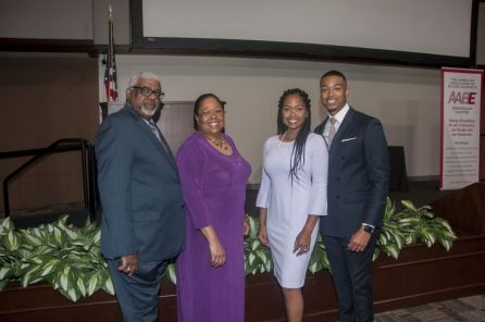 Speaker Julian Grant (right) is joined by his wife and parents after the luncheon. (Billy Brown)