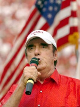"""Sylacauga native Jim Nabors (1930- ) sings the national anthem before the University of Alabama football game against the University of Hawaii at Bryant-Denny Stadium in Tuscaloosa in September 2006. The actor and vocalist is best known for his role as Gomer Pyle on """"The Andy Griffith Show"""" and """"Gomer Pyle, USMC."""" (From Encyclopedia of Alabama, courtesy of The Huntsville Times)"""