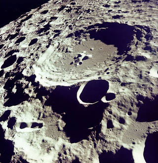 Crater 308 stands out in sharp relief in this photo from lunar orbit. (NASA)